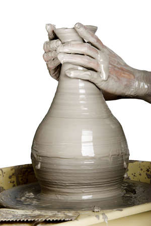 clay pot: Close-up picture of a potter works a potters wheel