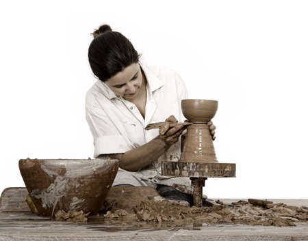 potters wheel: Picture of a potter works on a wood potters wheel Stock Photo