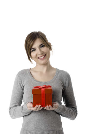 Portrait of a young woman holding a gift isolated on white background Stock Photo - 4091221