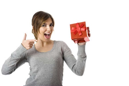 Portrait of a young woman pointing to the gift -  isolated on white background photo
