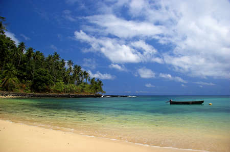 Beautiful beach with a great blue sky and turqoise water in Sao Tom� - Equator photo