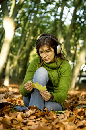 Portrait of a beautiful young woman listening music photo