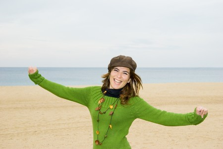 Beautiful happy woman on the beach smiling Stock Photo - 4556086
