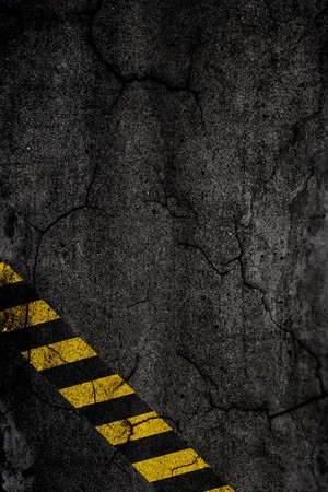 Asphalt background texture with construction signs  photo