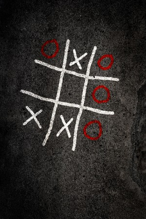 Noughts and Crosses game on paving Stock Photo - 4561497