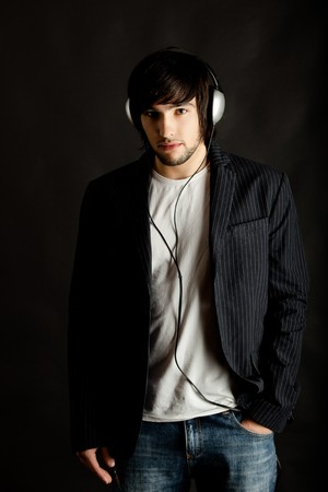 Young Man listening to music with headphones Stock Photo - 4556102