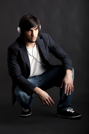 Young Man listening to music with headphones photo