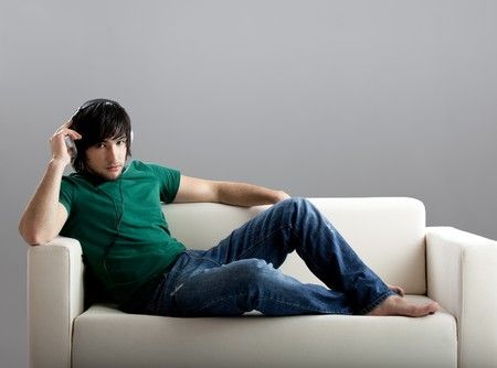 Young man listening music photo