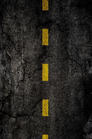分けられた黄色い線でアスファルト背景テクスチャ 写真素材