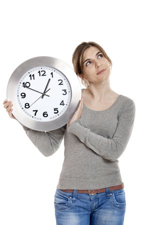 Beautiful woman standing over a white background holding a clock Stock Photo - 4880749