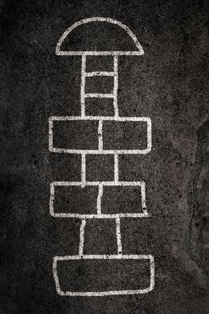 Hopscotch game designed on the road with chalk Stock Photo - 4885982