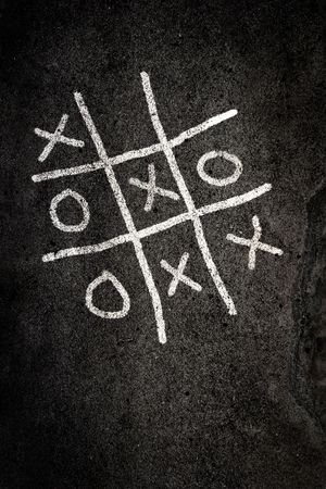cross recess: Noughts and Crosses game on paving Stock Photo