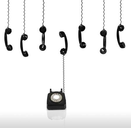 Multi old-fashioned telephones isolated on white photo