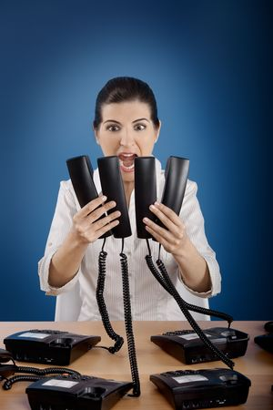 Businesswoman answering a lot of calls at the same time Stock Photo - 4917898