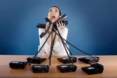 Businesswoman answering a lot of calls at the same time photo