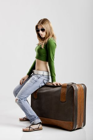 Beautiful young woman with old leather suitcases Stock Photo - 5036034