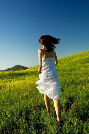 Young woman running on a beautiful springfield Stock Photo - 5186613