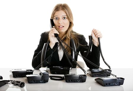 Beautiful woman working on a helpdesk answering a lot of calls at the same time Stock Photo - 5350876