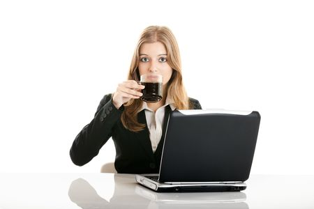 Portrait of a beautiful business woman in the office drinking a coffee Stock Photo - 5399432