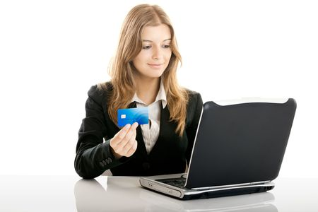 Portrait of a beautiful woman shopping online using a credit card photo