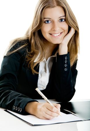 Portrait of a beautiful business woman in the office doing some paperwork Stock Photo - 5399421