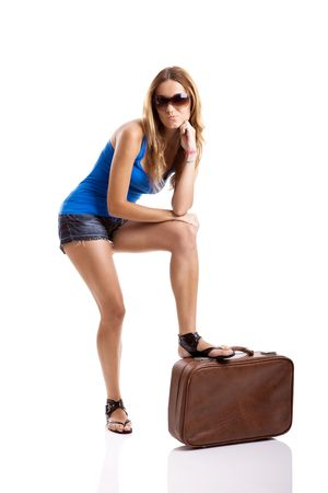 Beautiful and happy  young woman with old leather suitcase, isolated on white Stock Photo - 5636038