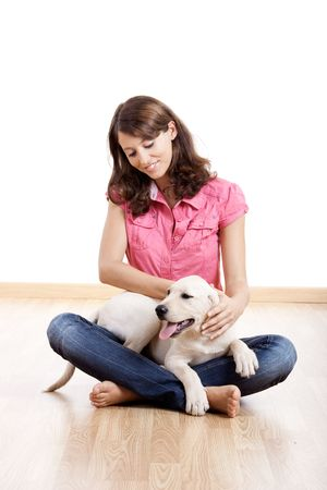 Young woman holding a beautiful and cute dog photo