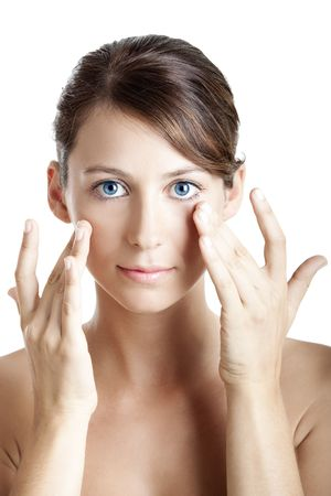 Beautiful young woman taking care of her skin face Stock Photo - 6246019