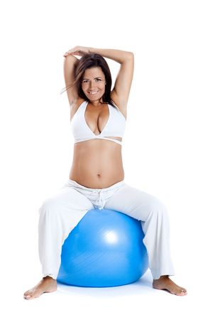Beautiful pregnant woman making exercises on a fitness ball Stock Photo - 6246040