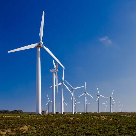 Wind turbines farm generating clean energy  trough the window Stock Photo - 6249786