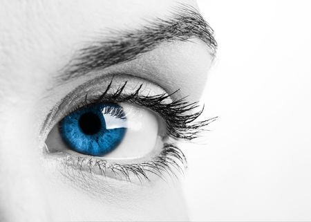 Close-up portrait of a beautiful female blue eye photo