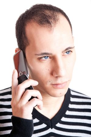 Young man talking on cellphone and worried with something, isolated on white background photo