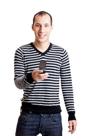 Happy young man holding a cellphone isolated on white background