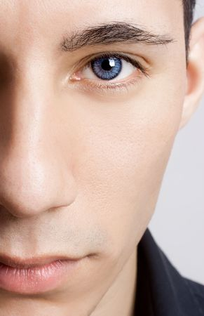 Fashion portrait of a young man with blue eyes - OBS: model use lens contact Stock Photo - 6631503