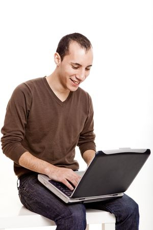Young man working on a laptop, isolated on white Stock Photo - 6700915