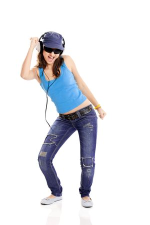 Beutiful girl listen music with headphones isolated on white photo