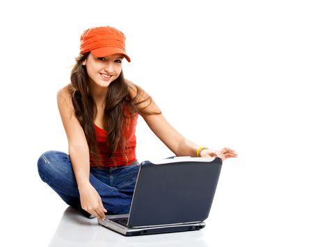 Beautiful young female student with a laptop, isolated on white photo