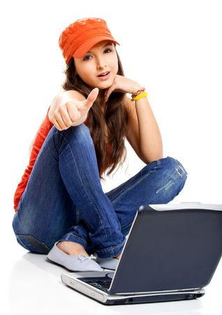 Beautiful young female student with thumbs up photo