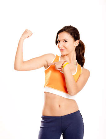 Portrait of a beautiful and athletic teenage girl showing her arm muscle Stock Photo - 6809264