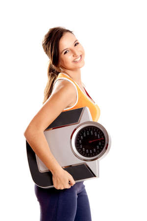 Portrait of a beautiful athletic girl holding a scale, isolated on white Stock Photo - 6809144