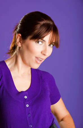 Portrait of a beautiful woman with a lovely espression, over a violet background Stock Photo - 6809421