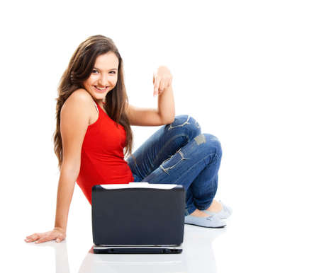 Beautiful young female student with a laptop, isolated on white Stock Photo - 6809457