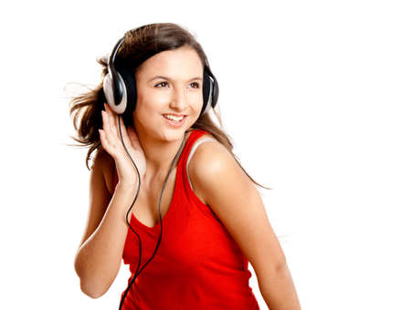 Beutiful girl listen music isolated on white photo