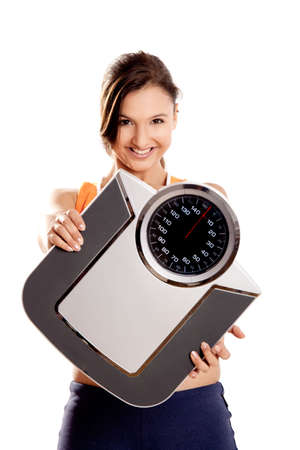 Portrait of a beautiful athletic girl holding a scale, isolated on white Stock Photo - 6809469