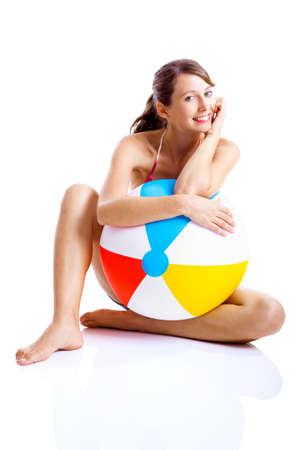 beachball: Beautiful young woman posing in bikini with a beach ball Stock Photo