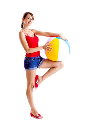 Beautiful young woman posing with a beach ball photo