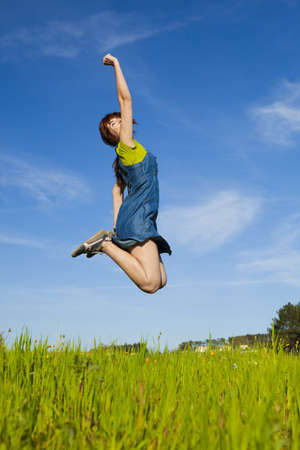 happy enjoy: Happy young woman jumping and enjoying the spring on a beautiful day