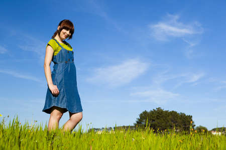 Portrait of a beautiful woman on a green meadow Stock Photo - 7111794