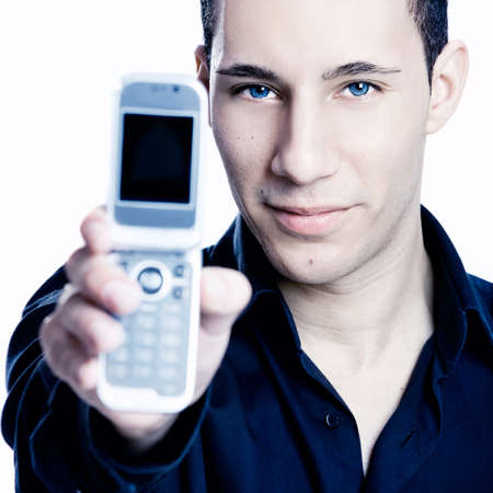 Young man showing a cell phone, toned in PS Stock Photo - 7150259