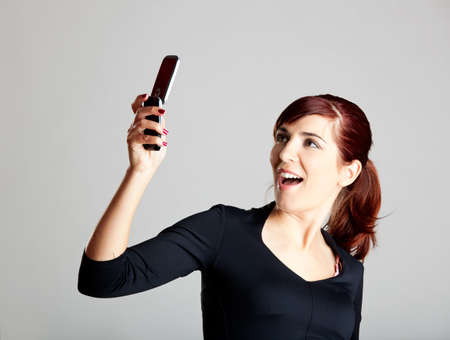 Portrait of a beautiful and attractive young woman making a phone call photo